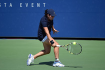 Ons Jabeur hits a backhand in the first round of the 2014 US Open.
