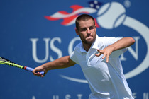 Mikhail Youzhny lines up a forehand on Day 1 of the US Open.