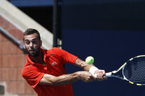 Benoit Paire of France hits a backhand in the first round Monday morning.