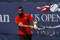 Benoit Paire of France lines up a backhand in the first round Monday morning.