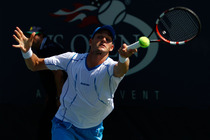 Blaz Rola returns a volley on Day 1 of the US Open.