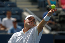 No. 13 John Isner in action in Arhtur Ashe Stadium on Day 2 of the US Open.