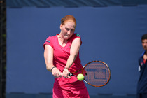 Alison Van Uytvanck hits a backhand on Day 2 of the US Open.