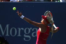Kristina Mladenovic serves in her first-round match on Day 2 of the 2014 US Open.