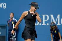 Little Black Dress, No. 2: Ana Ivanovic's dress bedazzled dress glistens under the sun on Arthur Ashe Stadium.