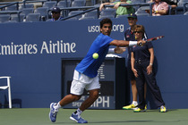 Maximo Gonzalez stretches for a backhand in his five-set first-round match.