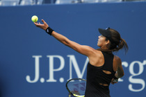 Ana Ivanovic starts her ball toss during her match in Arthur Ashe Stadium.