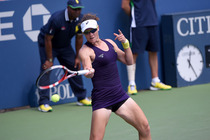 Samantha Stosur in purple during her first-round battle.