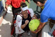 Australia's Samantha Stosur signing autographs after her first round victory.