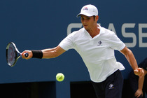Marcos Giron plays in his first round match on Day 2 of the US Open.