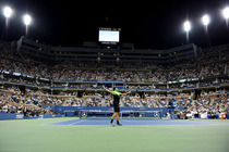 Marinko Matosevic serves during a first-round match against Roger Federer on Arthur Ashe Stadium.