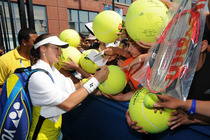 Martina Hingis signs autographs for fans at the 2014 US Open.