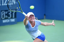 Aliaksandra Sasnovich lunges to connect with the ball in her match with Caroline Wozniacki.