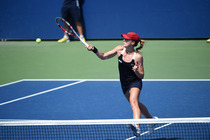 Alize Cornet in action on Court 5 on the third day of the 2014 US Open.