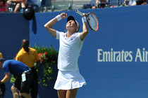 Johanna Larsson celebrates after beating Sloane Stephens in Arthur Ashe Stadium on Day 3 of the US Open.