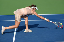 Andrea Petkovic lunges for a ball on Day 3 of the US Open.