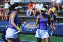 American's Raquel Kops-Jones and Abigail Spears in their first round match on Court 7.