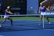 American's Raquel Kops-Jones and Abigail Spears in action on Day 3 of the 2014 US Open