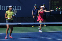 Zarina Diyas and Yi-fan Xu in their first round match of the 2014 US Open