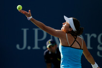 Alexandra Dulgheru prepares to serve on Day 3 of the 2014 US Open.