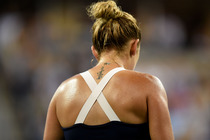 Timea Bacsinszky shows off her tattoo during her match on Arthur Ashe Stadium.