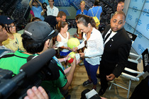 Martina Hingis signs autographs for fans after speaking in the Time Warner Cable Studios on Day 4.