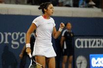 Zarina Diyas takes on Catherine Bellis in front of a packed house at the 2014 US Open.
