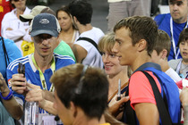 Andrey Kuznetsov takes a selfie with a fan after his second round victory at the 2014 US Open.