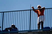 A fan takes in some of the action of the US Open.