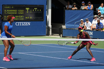 American's Asia Muhammad and Taylor Townsend in action on Court 4 of the 2014 US Open.