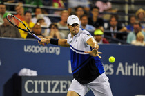 John Isner in action against Gael Monfils on Day 4 of the US Open.