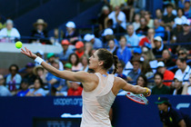 Andrea Petkovic prepares to serve in her third round match at the 2014 US Open.