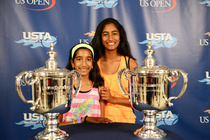 Fans of all ages pose with the trophies at USTA Membership Appreciation Day at the 2013 US Open.