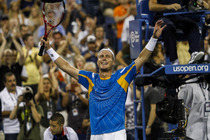 Lleyton Hewitt thanks fans following his 6-4, 5-7, 3-6, 7-6, 6-1 victory against Juan Martin del Potro on Day 5 of the US Open.