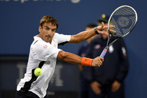 Tommy Robredo focuses on the ball before hitting a backhand.