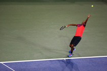 Nick Kyrgios serves during a third-round match against Tommy Robredo on Arthur Ashe Stadium.