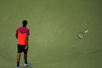 Nick Kyrgios throws his racquet during his third-round match against Tommy Robredo on Arthur Ashe Stadium.