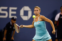 Camila Giorgi in action during her third round encounter with No. 6 seed Caroline Wozniacki.