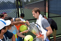 Andy Murray signs autographs for fans.