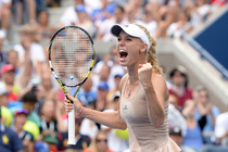 No. 10 seed Caroline Wozniacki celebrates after beating No. 5 Maria Sharapova during the round of 16 in Arthur Ashe Stadium.